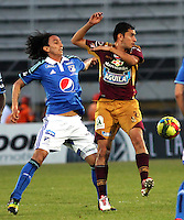 IBAGUE -COLOMBIA, 9-NOVIEMBRE-2014. Rafael Robayo (Izq)  de Millonarios disputa el balon con Felix Noguera del Deportes Tolima . Partido por la fecha 18 de la Liga Postobón 2014- II , jugado en el estadio Manuel  Murillo Toro de la ciudad de Ibague./  Rafael Robayo  of Millonarios  fights  the ball against  Felix Noguera  of Deportes Tolima. Match of  Party date 18th  2014 Postobón League II   played  Manuel Murillo Toro stadium in Ibague city.Photo / VizzorImage / Andrew Indell / Staff