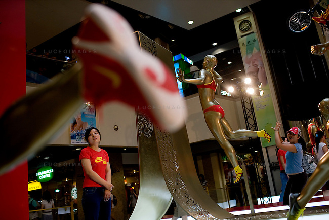 Nike created an elaborate Olympic Games display featuring gold athletes in mid action in the downtown shopping mall in Beijing, China on Sunday, August 10, 2008.  Kevin German