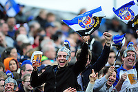 Bath Rugby supporters in the crowd celebrate. Aviva Premiership match, between Bath Rugby and Sale Sharks on April 23, 2016 at the Recreation Ground in Bath, England. Photo by: Patrick Khachfe / Onside Images