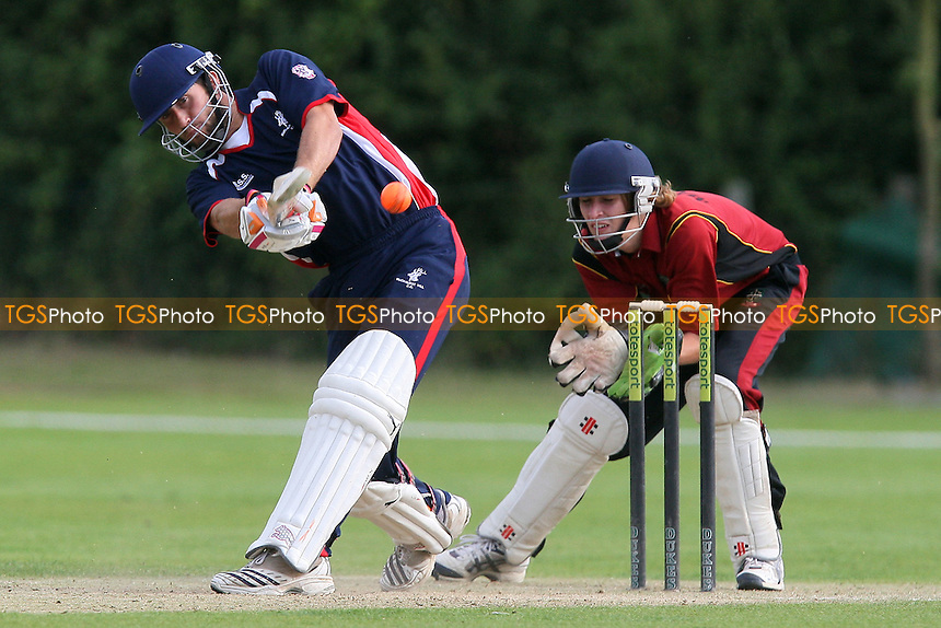 Rob Petchey in batting action for Buckhurst Hill as Max Shirt keeps wicket - South Woodford CC (red) vs Buckhurst Hill CC in the Final - Dukes Essex Twenty 20 Cricket Finals Day at Billericay Cricket Club - 15/08/10 - MANDATORY CREDIT: Gavin Ellis/TGSPHOTO - Self billing applies where appropriate - Tel: 0845 094 6026