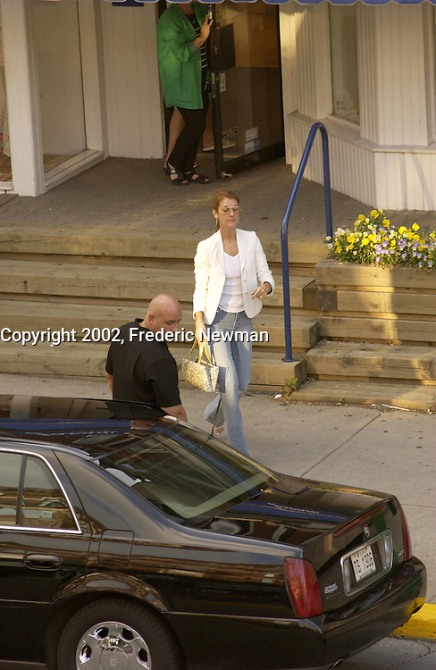 July 27  2002,Montreal, Quebec, Canada; <br /> <br /> EXCLUSIVE PHOTO <br /> Celine Dion walk out of Jacadi, kid clothing store, on Laurier street in Montreal, July 27,  2002, while one of her bodyguards stand by the limo.<br /> <br /> (Mandatory Credit: Photo by Frederic Newman - Images Distribution (&copy;) Copyright 2002 by Frederic Newman<br /> <br /> Worlwide rights (except  Canada) exclusive to Famous UK , Canada Out<br /> <br /> NOTE :  D-1 X original JPEG, saved as Adobe 1998 RGB