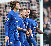 Eden Hazard of Chelsea (2nd left) celebrates after he scores his team's third goal of the game to make the score 3-1 during the Premier League match between Chelsea and Newcastle United at Stamford Bridge, London, England on 2 December 2017. Photo by David Horn.