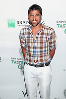 Tennis player Janko Tipsarevic and guest attend the 13th Annual 'BNP Paribas Taste of Tennis' at the W New York.  New York City, August 23, 2012. &copy;&nbsp;Diego Corredor/MediaPunch Inc. /NortePhoto.com<br />