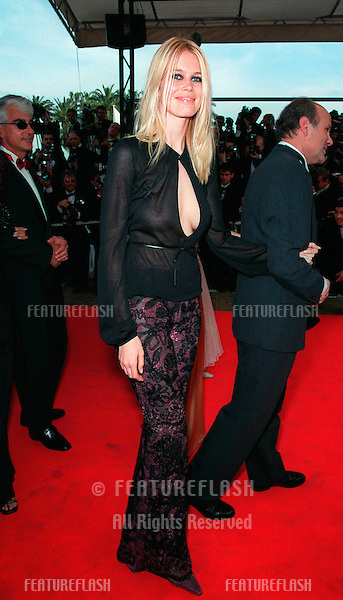 "12MAY99:  Supermodel CLAUDIA SCHIFFER arriving at the gala opening of the 52nd Cannes International Film Festival. The opening movie was ""The Barber of Siberia."".© Paul Smith / Featureflash"