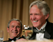 United States President George W. Bush, (L) and President  of the White House Correspondents' Association Ron Hutcheson, laugh during one of the many light moments of the annual White House Correspondents' Association dinner at the Washington Hilton in Washington, D.C., Saturday 30 April 2005. The annual dinner began in 1914 as a bridge between the White House and its media corps and tonight feautured a mix of political insiders including Supreme Court Justices, Antonin Scalia and Stephen Breyer, and Hollywood elite such as Goldie Hawn and Richard Gere.  <br /> Credit: Katie Falkenberg - Pool via CNP