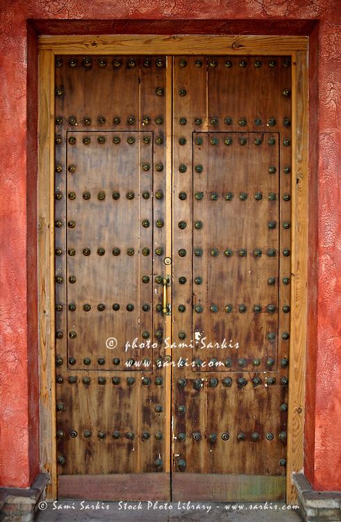 Spiked wooden door, Tarifa, Andalusia, Spain.