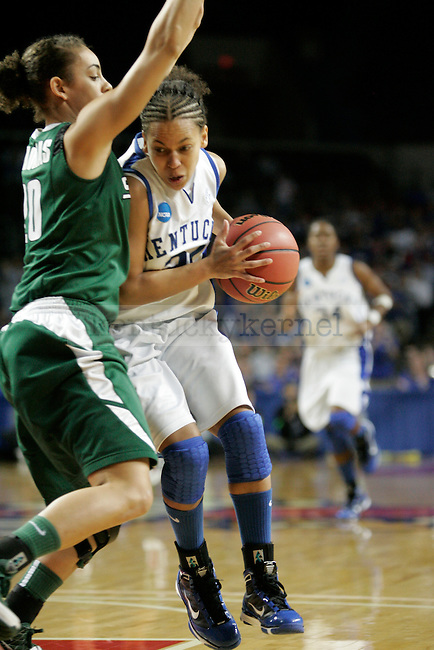 UK's Amber Smith drives against Michigan State at Freedom Hall on Monday, March 22, 2010. Photo by Scott Hannigan | Staff