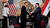 Baghdad, Iraq - April 7, 2009 -- United States President Barack Obama shakes hands with Iraqi Prime Minister Nouri al-Maliki at the conclusion of their meeting Tuesday, April 7, 2009 in Baghdad, Iraq. .Credit: Pete Souza - White House via CNP