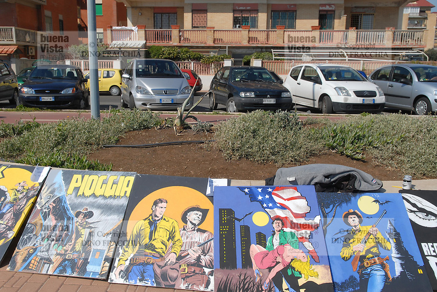 - Lido di Ostia, exhibition of paintings on seafront sidewalk....- Lido di Ostia, mostra di quadri sul marciapiede del lungomare