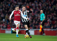 Héctor Bellerín of Arsenal and Javi Manquillo of Newcastle United in action during the Premier League match between Arsenal and Newcastle United at the Emirates Stadium, London, England on 16 December 2017. Photo by Vince  Mignott / PRiME Media Images.