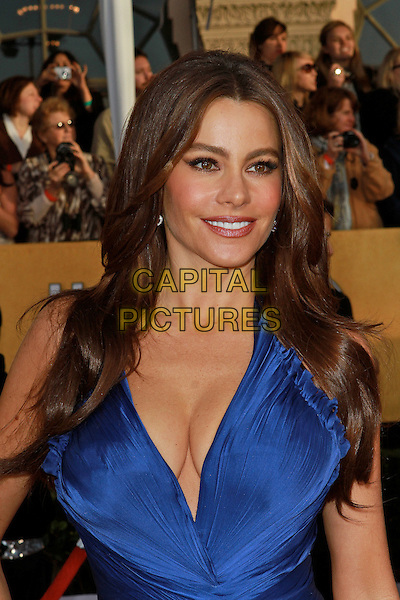 SOFIA VERGARA .at the 17th Screen Actors Guild Awards held at The Shrine Auditorium in Los Angeles, California, USA,.January 30th 2011..SAG Sags arrivals portrait headshot blue cleavage low cut smiling halterneck ruffle pleated .CAP/ADM/KB.©Kevan Brooks/AdMedia/Capital Pictures.