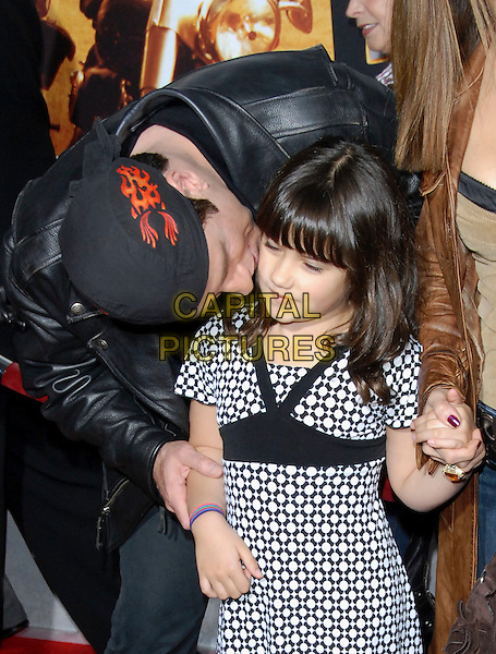 "JOHN TRAVOLTA & DAUGHTER.attends The Touchstone Pictures' World Premiere of ""Wild Hogs"" held at The El Capitan Theatre in Hollywood, California, USA, February 27 2007. .half length family father dad  bending down kissing.CAP/DVS.©Debbie VanStory/Capital Pictures"