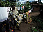 A woman hangs laundry in Karonga, a town in northern Malawi.
