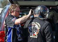 Feb 12, 2016; Pomona, CA, USA; Crew member with NHRA funny car driver Terry Haddock during qualifying for the Winternationals at Auto Club Raceway at Pomona. Mandatory Credit: Mark J. Rebilas-USA TODAY Sports