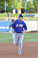 Allan Dykstra (10) of the Las Vegas 51s rounds the bases after hitting a home run in action against the Salt Lake Bees at Smith's Ballpark on May 8, 2014 in Salt Lake City, Utah.  (Stephen Smith/Four Seam Images)