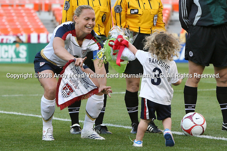 10 May 2008: Christie Rampone (USA) (left) receives flowers from her daughter Rylie Cate Rampone (right) before the game played one day before Mother's Day. The United States Women's National Team defeated the Canada Women's National Team 6-0 at RFK Stadium in Washington, DC in a women's international friendly soccer match.