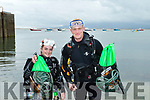 Caoimhe Feely from Tralee and Corbin Bakeberg of South Africa, now living in the Maherees, both attached to WaterWorld Dive Centre, The Maherees, pictured last Monday July 30 at Fahamore pier with samples of the rubbish collected from the seabed in the area, so on Saturday August 17 next they will have up to 30 divers embarking a huge clean up of the entire area.