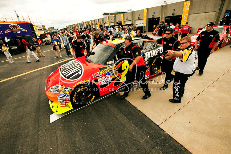 Team members for Jeff Gordon's DuPont Chevrolet prepare for the start of the 2009 Coca-Cola Classic 600 race at the Lowe's Motor Speedway, in Concord, NC. NASCAR Driver David Reutimann ultimately won the race, and his first Sprint Cup, during the rain-shortened event, held May 25, 2009. NASCAR's longest scheduled race went only 227 laps, or 340.5 miles, before officials ended it because of rain. The 2009 race was the 50th running of the Coca-Cola 600. Ryan Newman and Robby Gordon finished second and third respectively.