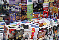 Spanish-language books for sale in a sidewalk stand in downtown Mexico City