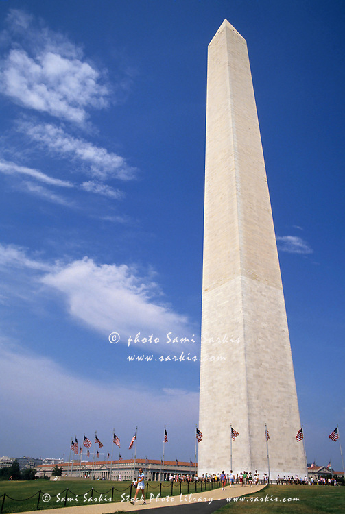 Washington Monument surrounded by American flags, Washington DC, USA.