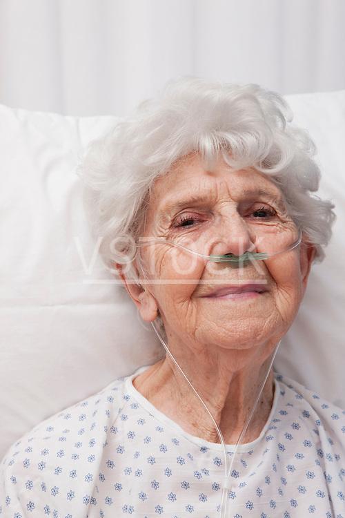 USA, Illinois, Metamora, Portrait of senior woman wearing oxygen tubes