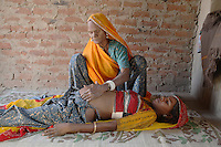 Maithi is a dalit (untouchable) who has been trained as a mid-wife by Barefoot College. Her work is challenging the caste system in rural Rajasthan as she touches (literally) many women from different / higher castes in her daily rounds as a midwife. Here she is checking a young woman who will give birth in a few days time...