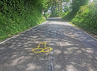 Pictured: The phallic shaped yellow graffiti highlighting a pothole near Crundale, west Wales, UK.<br /> Re: Pembrokeshire hyas been struck by a notorious mystery graffiti artist known for using obscene images to highlight the blight of potholes.<br /> A bright yellow spray painted penis has been spotted scrawled over a pothole near Crundale, west Wales.<br /> The piece of graffiti was potentially inspired by a protest artist known as Wanksy, who began spray painting penises onto potholes around Greater Manchester in 2015 and gained a viral following.<br /> This treatment has since become the hallmark of a UK-wide phenomenon where residents take pothole management into their own hands. <br /> Wanksies have arisen to protest potholes in Cambridgeshire and Essex in the last few years, among other places.<br /> A motorist who did not wish to be named spotted the piece of graffiti.<br /> &quot;I was shocked and appalled when I saw it, that sort of thing really rubs me up the wrong way,&quot; said the motorist.<br /> &quot;I was just driving home for lunch. I had to pull off the road when I noticed it,&quot; they added.<br /> &quot;Obviously potholes are a pain, but is this the way to highlight them? I don't think so: someone needs a stiff talking to!&quot;