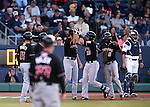 Albuquerque Isotopes' Dustin Garneau is greeted at the plate after hitting a grand slam against the Reno Aces in Reno, Nev., on Saturday, April 18, 2015. The Isotopes won 9-4. <br /> Photo by Cathleen Allison