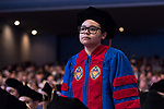 Terrie Sullivan stands to be recognized as a recipient of a Student Service Award during the DePaul University College of Law commencement ceremony, Sunday, May 14, 2017, at the Rosemont Theatre in Rosemont, IL, where some 240 students received their Juris Doctors or Master of Laws degrees. The Rev. Dennis H. Holtschneider, C.M., president of DePaul, conferred the degrees. (DePaul University/Jeff Carrion)