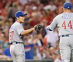 (L-R) Tsuyoshi Wada, Anthony Rizzo (Cubs),<br /> JULY 8, 2014 - MLB :<br /> Pitcher Tsuyoshi Wada of the Chicago Cubs high fives first baseman Anthony Rizzo in the fifth inning during the second game of a Major League Baseball doubleheader against the Cincinnati Reds at Great American Ball Park in Cincinnati, Ohio, United States. (Photo by AFLO)