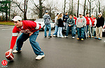 WOLCOTT, CT. 11/25/04--112504SV02--Dave Mantz,18, a 2004 graduate of Wolcott High hikes a ball while  tailgating with friends at Wolcott High's Thanksgiving Day game against Holy Cross but,  found out the game was postponed Thursday. The game will be played Friday morning.   Steven Valenti Photo<br /> (Dave Mantz,(cq))