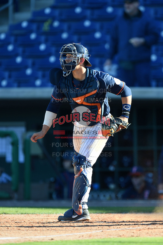 Cal State Fullerton Titans catcher Chris Hudgins (24) warmup throw down to second during a game against the Alabama State Hornets on February 14, 2015 at Bright House Field in Clearwater, Florida.  Alabama State defeated Cal State Fullerton 3-2.  (Mike Janes/Four Seam Images)