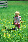 Lisa Young running with puppy in Spring. 3 years old.