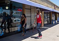 Jun. 10, 2013; Phoenix, AZ, USA: Phoenix Mercury center Brittney Griner (right) walks with her girlfriend to the Golden Rule Tattoo shop in downtown Phoenix. Mandatory Credit: Mark J. Rebilas-