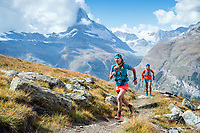 Trail running above Zermatt with the first views of the Matterhorn while on the Via Valais, a multi-day trail running tour connecting Verbier with Zermatt, Switzerland.