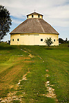 Lenox Round Barn at the Taylor County Museum--pale yellow round barn with shake roof..
