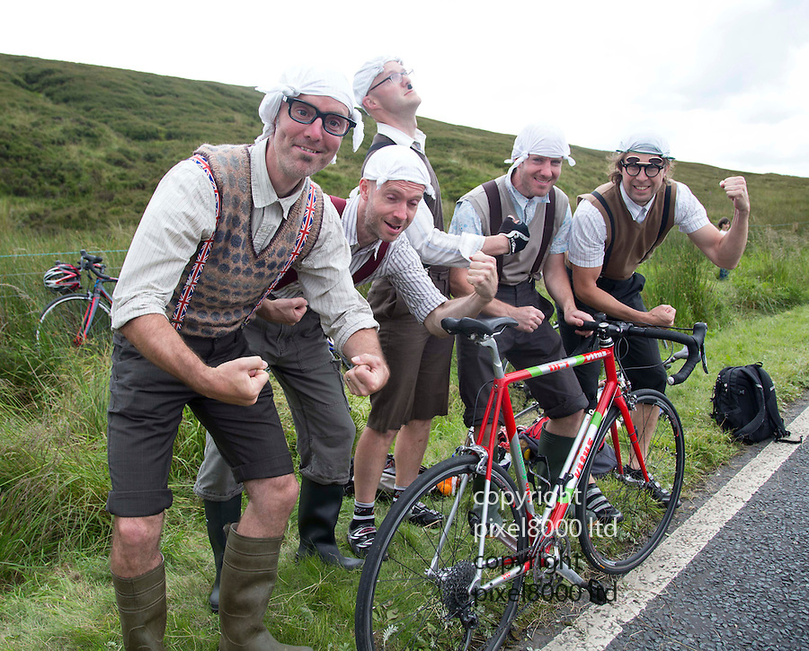 """Grand Depart - Tour de France 2014<br /> Yorkshire England.<br /> Second stage passes through """"Blubberhouses Moor""""<br /> on the road from Harrogate<br /> Cycling fans dressed as Monty Python  """"Gumby"""" Gumbys<br /> characters.<br /> from the famous sketch<br /> Merrell Brothers - Andy, Martin, Gary, Simon - with their friend also Martin.<br /> <br /> <br /> <br /> Pic by Gavin Rodgers/Pixel 8000 Ltd"""