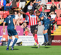 Lincoln City's John Akinde vies for possession with Bristol Rovers' Tom Davies<br /> <br /> Photographer Chris Vaughan/CameraSport<br /> <br /> The EFL Sky Bet League One - Lincoln City v Bristol Rovers - Saturday 14th September 2019 - Sincil Bank - Lincoln<br /> <br /> World Copyright © 2019 CameraSport. All rights reserved. 43 Linden Ave. Countesthorpe. Leicester. England. LE8 5PG - Tel: +44 (0) 116 277 4147 - admin@camerasport.com - www.camerasport.com