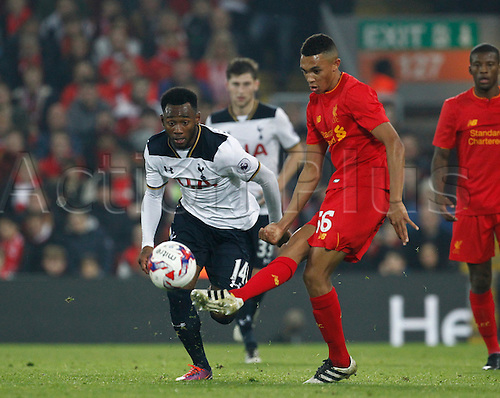 25.10.2016. Anfield, Liverpool, England. EFL Cup. Liverpool versus Tottenham Hotspur. Liverpool midfielder Trent Alexander-Arnold, making his debut for Liverpool tonight, passes as Tottenham midfielder Georges-Kevin Nkoudou challenges.