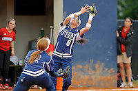 11 February 2012:  FIU's Jessy Alfonso (8) catches a foul ball as Ashley McClain (2) positions herself to assist as the University of Louisville Cardinals defeated the FIU Golden Panthers, 4-2, as part of the COMBAT Classic at the FIU Softball Complex in Miami, Florida.