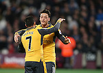 Arsenal's Mesut Ozil celebrates scoring his sides opening goal during the Premier League match at the London Stadium, London. Picture date December 3rd, 2016 Pic David Klein/Sportimage