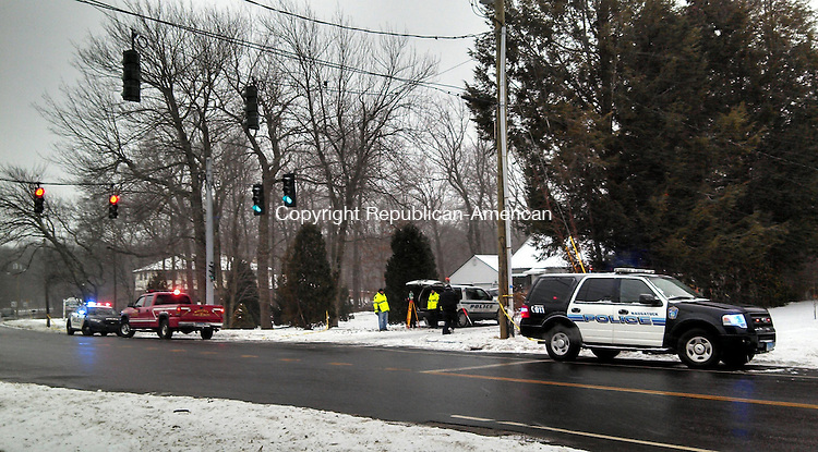WOLCOTT, CT - Jan. 25, 2014 - 012514AL01 - A vehicle went off the road at the intersection of Long Swamp Road and Wolcott Road around 1:30 p.m. Friday in Wolcott. The vehicle continued into the woods where it struck a tree. The driver died at the scene. Andrew Larson / Republican-American
