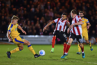 Lincoln City's Nathan Arnold vies for possession with Chester's Ryan Astles, while Lincoln City's Harry Anderson looks for an opportunity<br /> <br /> Photographer Andrew Vaughan/CameraSport<br /> <br /> Vanarama National League - Lincoln City v Chester - Tuesday 11th April 2017 - Sincil Bank - Lincoln<br /> <br /> World Copyright &copy; 2017 CameraSport. All rights reserved. 43 Linden Ave. Countesthorpe. Leicester. England. LE8 5PG - Tel: +44 (0) 116 277 4147 - admin@camerasport.com - www.camerasport.com