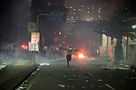 A protestor runs to take cover from special elite police forces who were shooting tear gas and rubber bullets at protestors, in downtown, in Rio de Janeiro, Brazil, on Thursday, June 20, 2013. <br /> <br /> About 300,000 Cariocas (residents of Rio de Janeiro) protest downtown against the government, which began with a 20-cent hike in public transport fares, and moved to widespread frustration about a heavy tax burden, corrupt politicians and weak public education, health and transport systems, as the nation hosts the Confederations Cup soccer tournament and prepares for next month's papal visit.<br /> <br /> The demonstrations came despite the government's U-turn over public transport fare hikes which sparked the protests over a week ago.