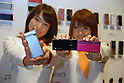 Models show mobile carrier KDDI au?s new mobile handsets for the spring season. 19 January, 2009. (Taro Fujimoto/JapanToday/Nippon News) TOKYO --<br /> <br /> Mobile carrier KDDI au on Thursday unveiled 12 new mobile handsets for the spring season. The new handsets are made by Sony Ericsson, Hitachi, Toshiba, Casio, Sharp, Panasonic, Kyocera for consumers and HCT for corporate users.