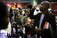 SOWETO, SOUTH AFRICA SEPTEMBER 2: Up-market black people sips vine during a yearly Vine and Brandy festival on September 2, 2006 in Soweto, Johannesburg, South Africa. Many of the country&rsquo;s vine makers came to Soweto to introduce the newly economically empowered people about vine. Traditionally, most people drink beer and whiskey and the vine makers are targeting a new black elite that have money to spend. Soweto is South Africa&rsquo;s largest township and it was founded about one hundred years to make housing available for black people south west of downtown Johannesburg. The estimated population is between 2-3 million. Many key events during the Apartheid struggle unfolded here, and the most known is the student uprisings in June 1976, where thousands of students took to the streets to protest after being forced to study the Afrikaans language at school. Soweto today is a mix of old housing and newly constructed townhouses. A new hungry black middle-class is growing steadily. Many residents work in Johannesburg but the last years many shopping malls have been built, and people are starting to spend their money in Soweto.  <br /> (Photo by Per-Anders Pettersson)