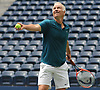 John McEnroe gets ready to serve during an exhibition doubles match at the newly-reopened Louis Armstrong Stadium in Corona, NY on Wednesday, Aug. 22, 2018. The 14,000 seat stadium which features a retractable roof will host US Open matches starting Monday, Aug. 27.
