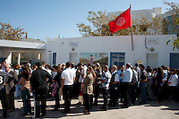 Tunis. 23 October 2011. .90% of registered voters waited in line for hours at the polling station at the Ecole Mendes France to cast a vote in the first free elections in Tunisia's history. ..In front of Ecole Mendes France.