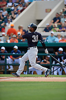 New York Yankees center fielder Aaron Hicks (31) hits a double during a Grapefruit League Spring Training game against the Detroit Tigers on February 27, 2019 at Publix Field at Joker Marchant Stadium in Lakeland, Florida.  Yankees defeated the Tigers 10-4 as the game was called after the sixth inning due to rain.  (Mike Janes/Four Seam Images)