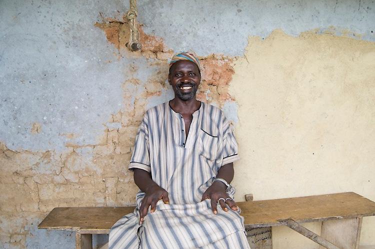 Alhaji Dauda Sheriff sitting outside his house in the village of Mandopohlun, Kailahun District. Sierra Leone. Photo taken May 2, 2010.